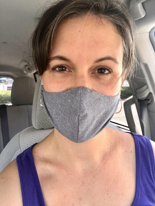 Kristen wearing a gray fabric face mask