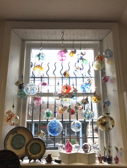 blown glass balls hanging in window
