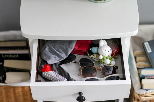 nightstand drawer with sunglasses inside