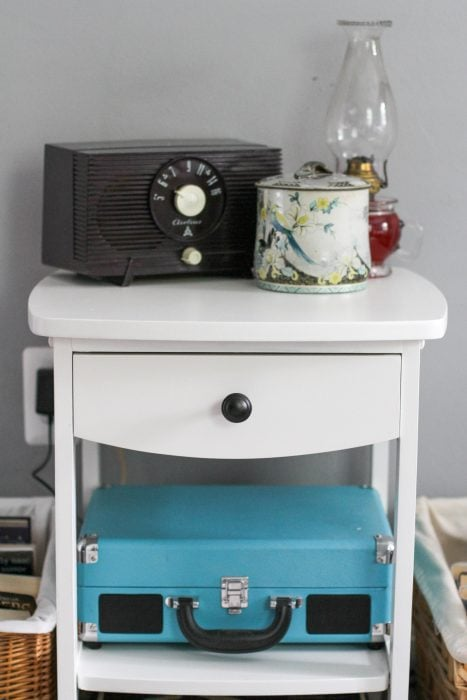 white painted nightstand with vintage accessories