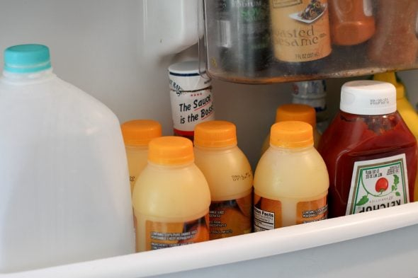 OJ bottles in fridge door