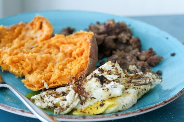 sweet potato, sausage, and fried eggs