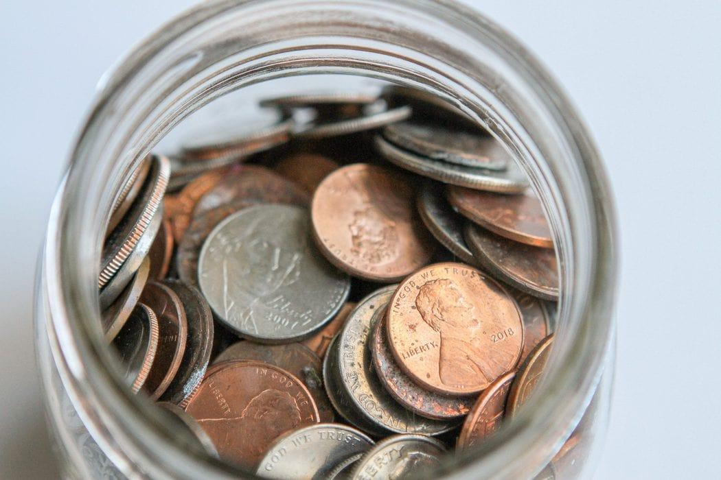 A glass jar of coins.