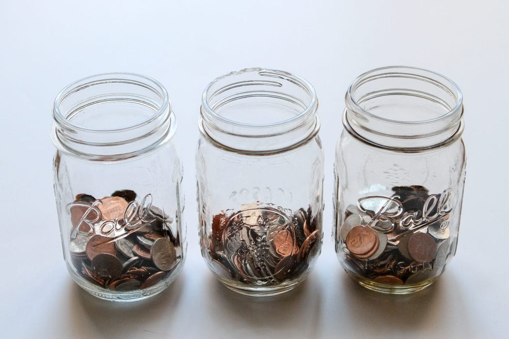 Three glass jars of coins.