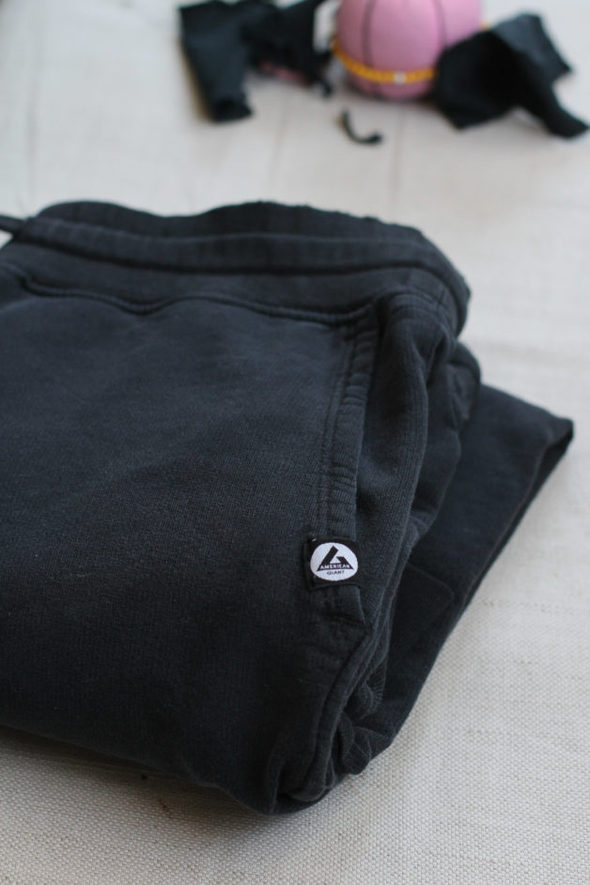A black pair of American Giant joggers, folded up.