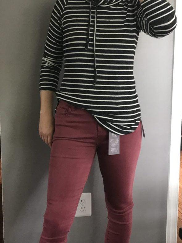 Kristen in red skinny jeans.