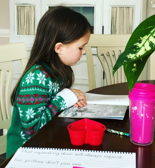 little girl doing schoolwork