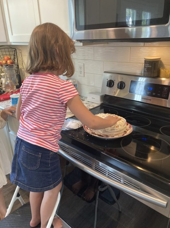 little girl making a dessert