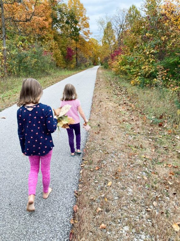 two girls walking on a path