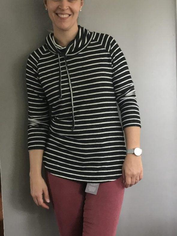Kristen in a striped cowl-neck top.