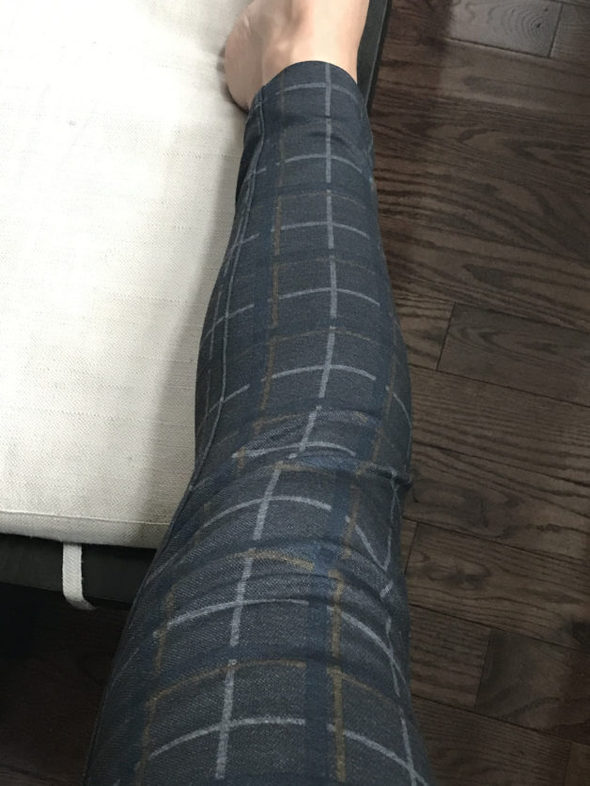 Kristen's leg in a pair of plaid pants.