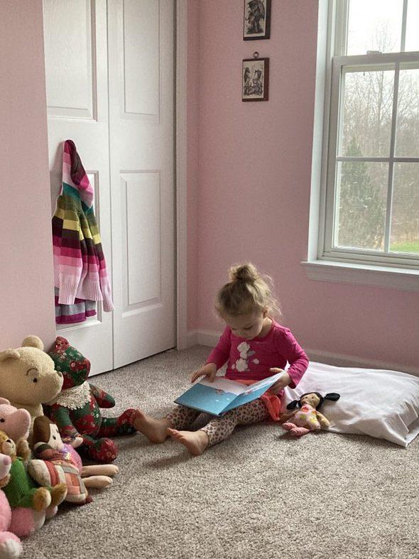 toddler on floor reading
