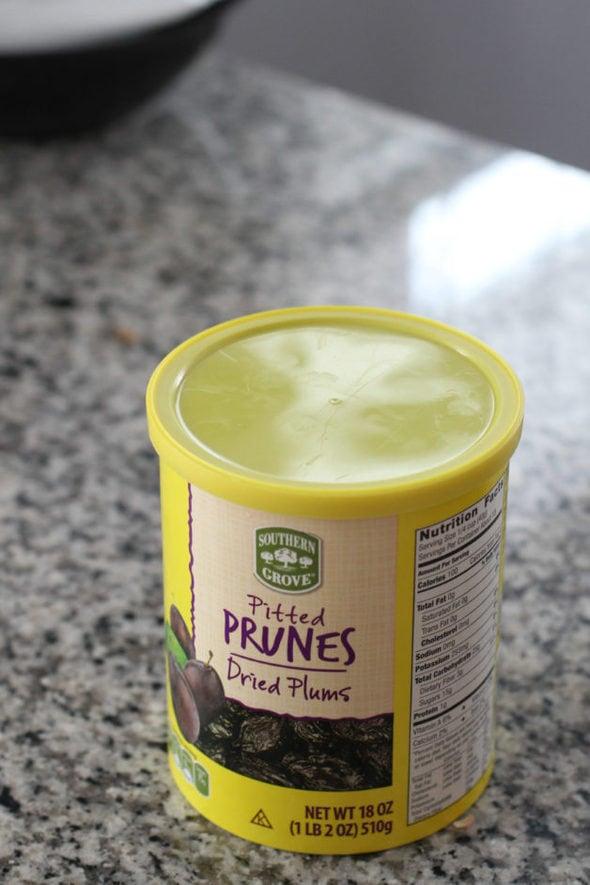 Aldi prune container on the countertop.