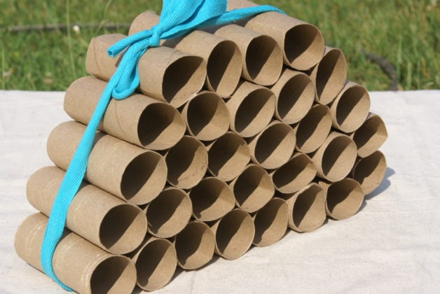 toilet paper tubes tied with a ribbon