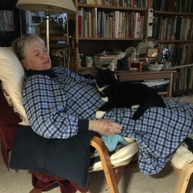 Erika with tuxedo cat on lap.