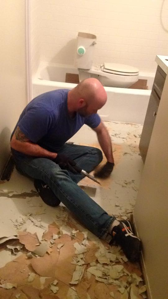 Reese's husband ripping out tile.