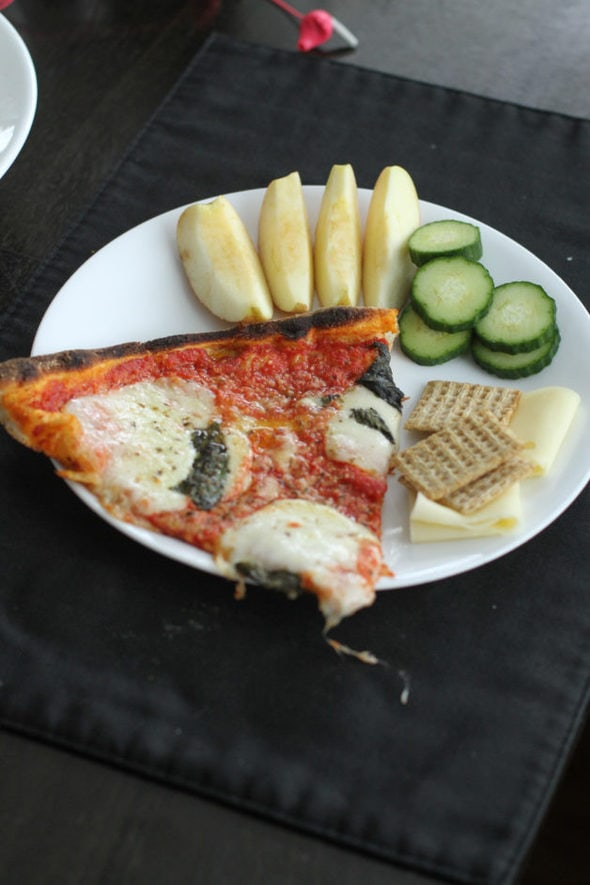 Leftover pizza with produce.