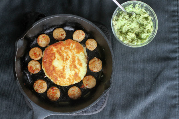 Potato patty with sausage and guacamole.