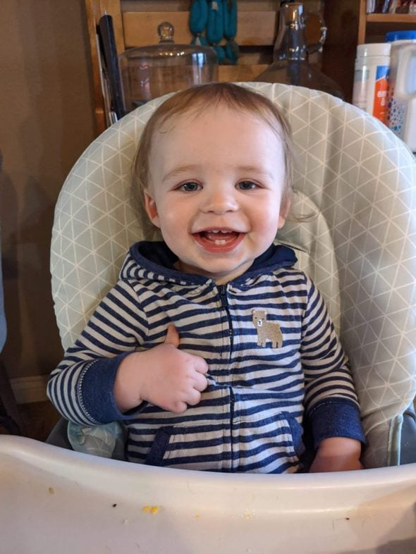 Reese's son in a high chair.