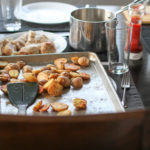 Roasted potatoes on a dining room table.