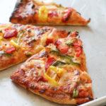 Three slices of veggie pizza.