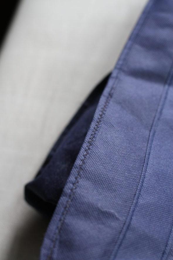 Navy blue repaired polypropylene bag.