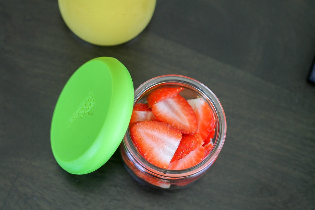 Oui yogurt container with strawberries inside.
