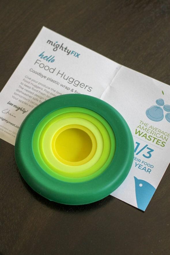 Set of green Food Huggers lids.