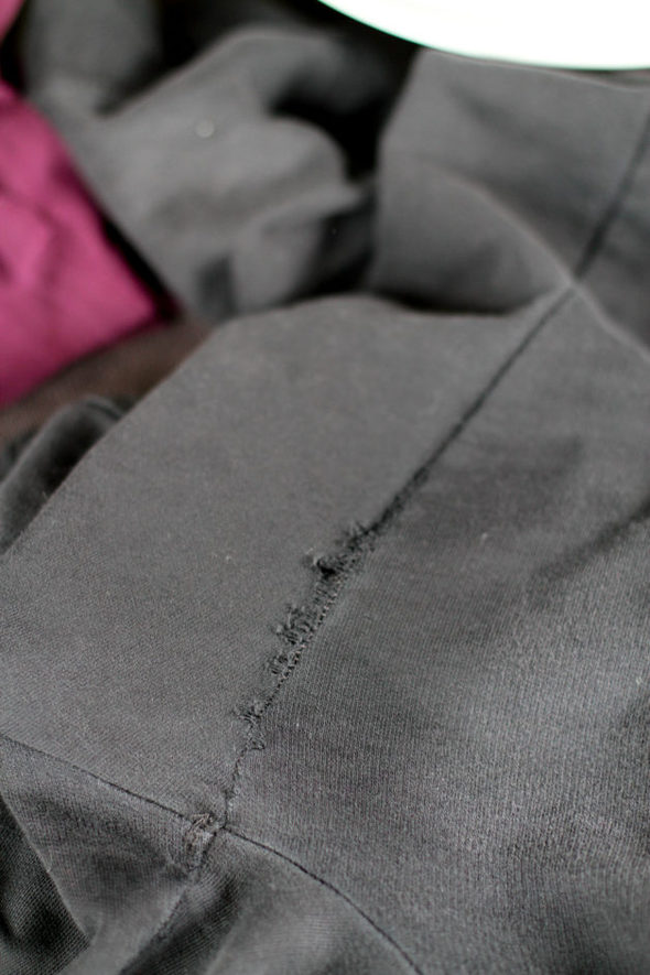 Black joggers with thigh seam wear.