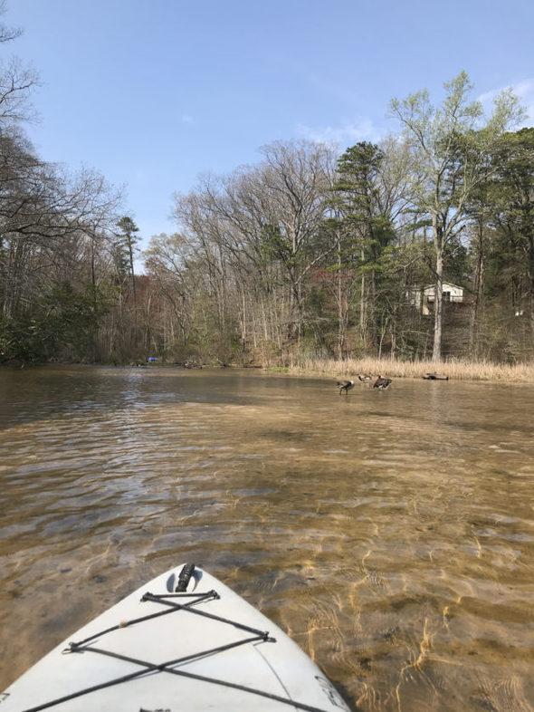 kayak tip in river.