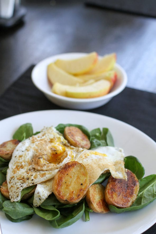 green salad with eggs and potatoes.