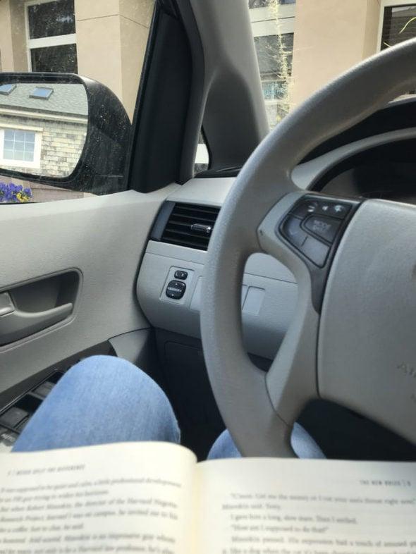 Reading in the van.