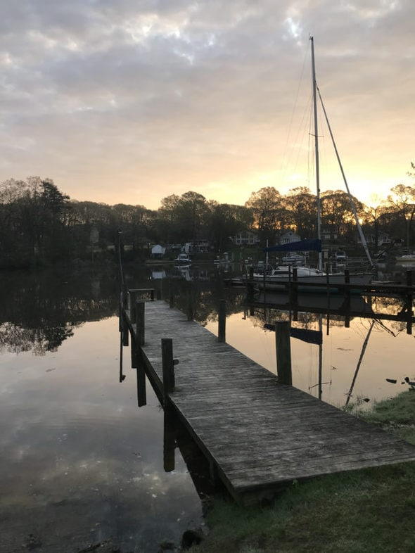 A dock on the river at sunrise.