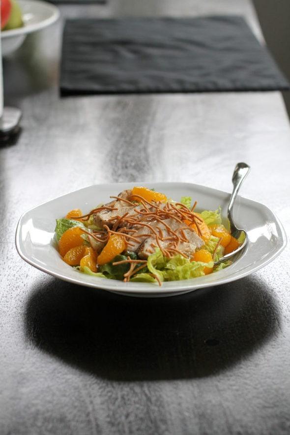 Mandarin chicken salad in a white bowl.