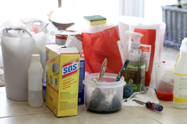 Cleaning supplies on a tile floor.