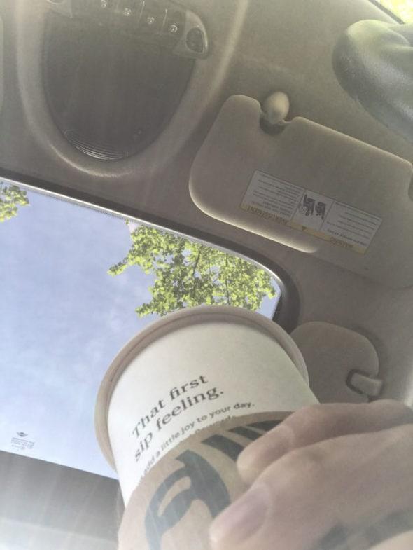 Blue sky through a car's sunroof.