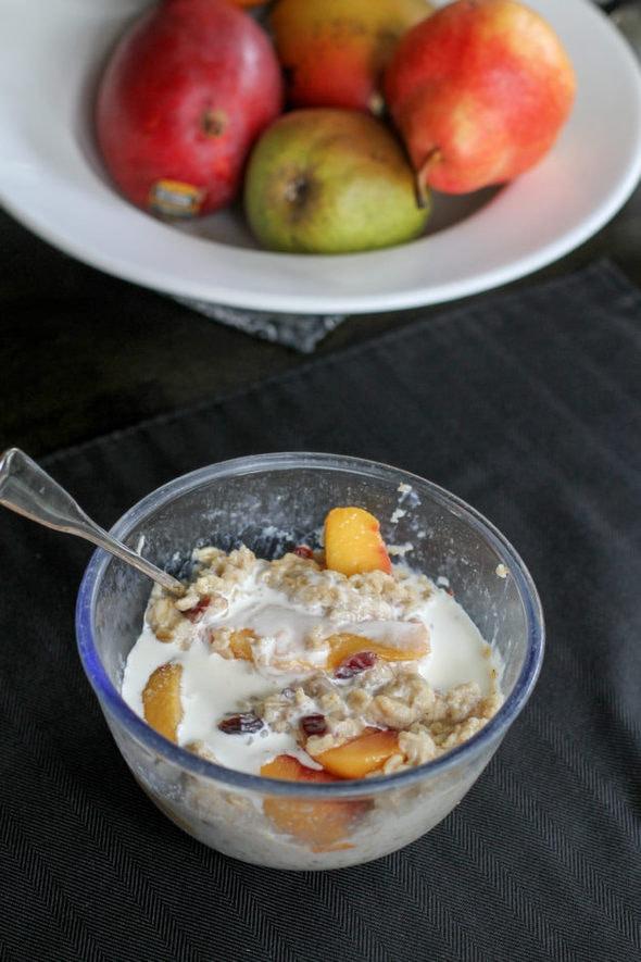 Peach cranberry oatmeal in a blue bowl.