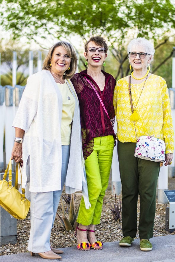 Three ladies dressed in spring outfits with fall colors.
