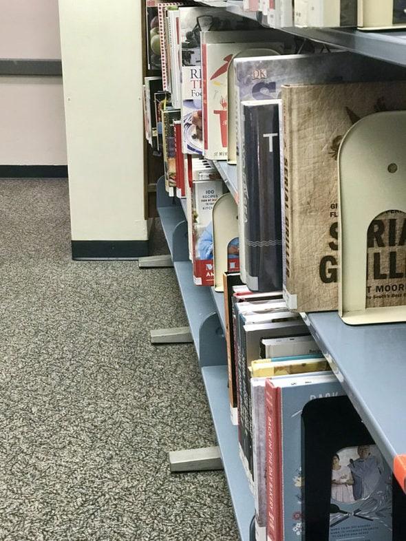 A library shelf full of cookbooks.