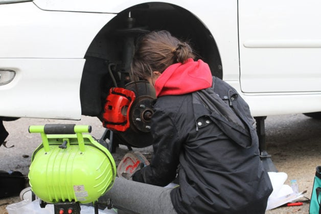 Lisey painting her calipers red.
