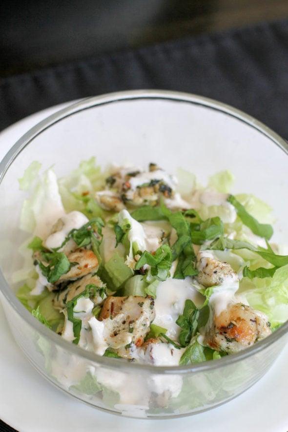 Chicken spiedies salad in a glass bowl.