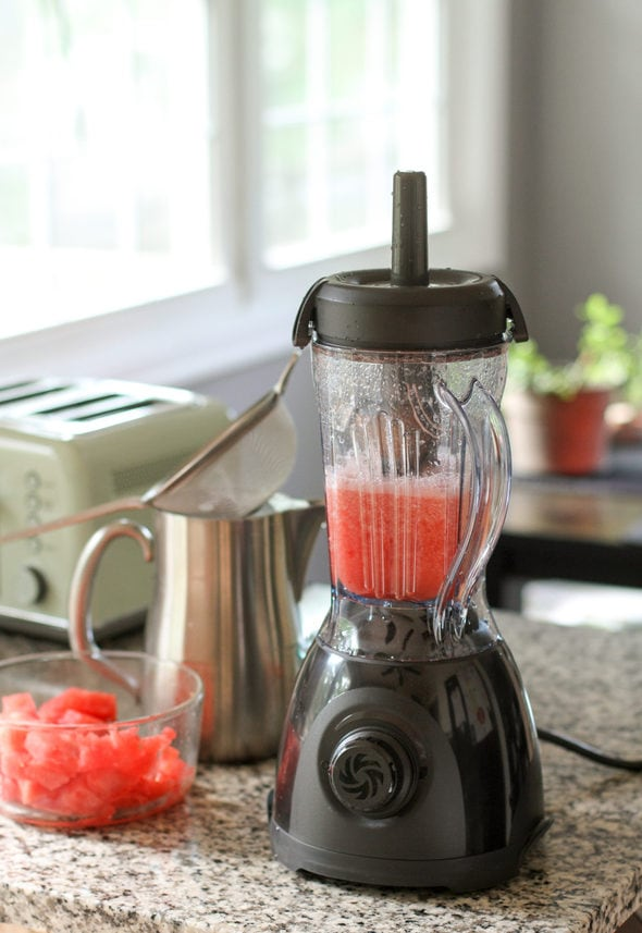Vitamix One blender with watermelon inside.