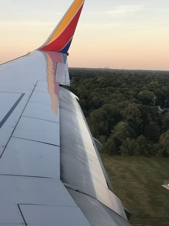 A Southwest plane wing at sunset.