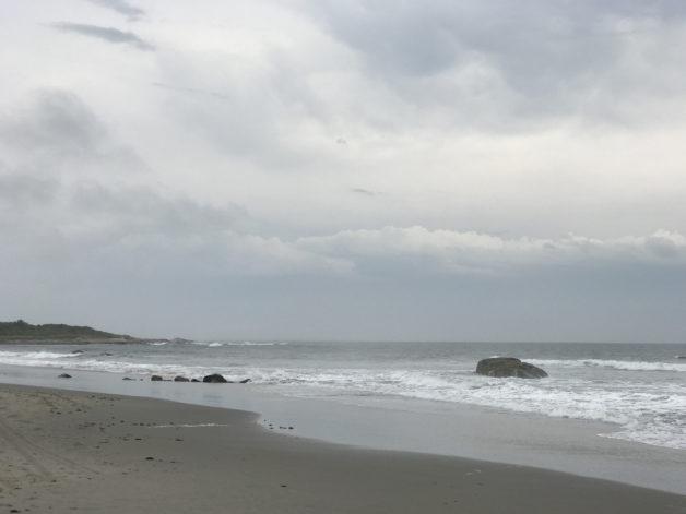 A Rhode Island beach under cloudy skies.