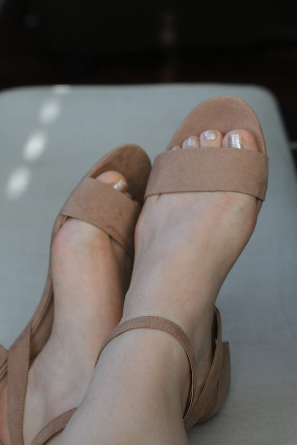 A pair of brown sandals.