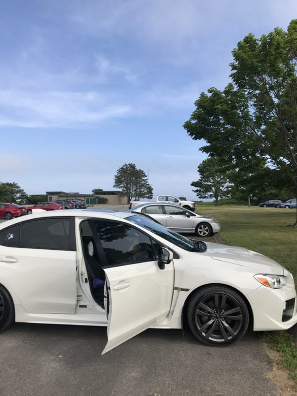 A white WRX in a Maine parking lot.