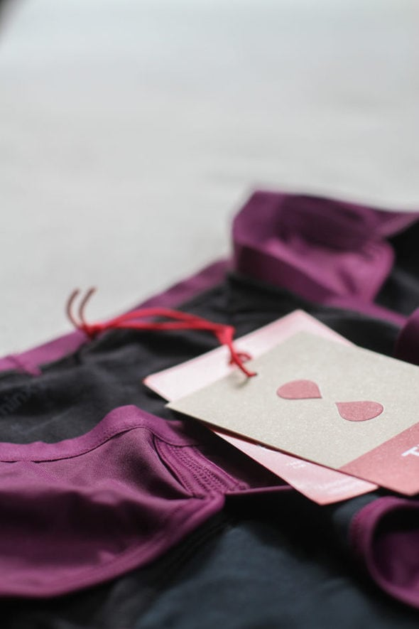 A purple pair of Thinx undies with the tags attached.