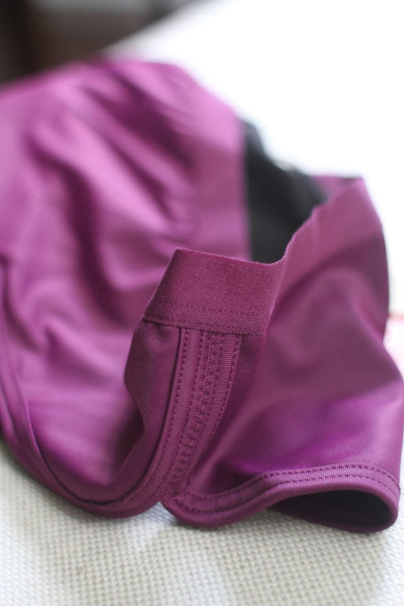 The elastic waistband of a purple pair of Thinx underwear.