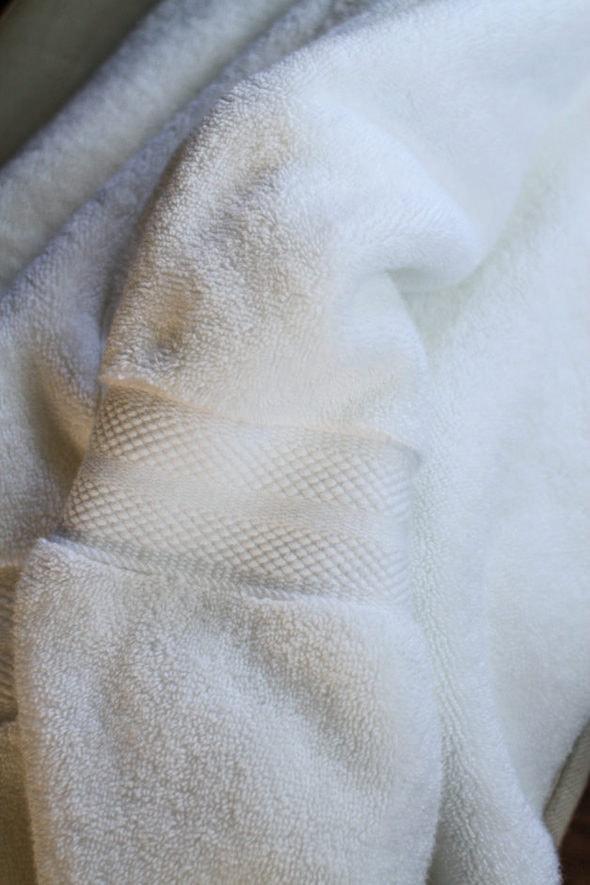 A fluffy white cotton bath towel.