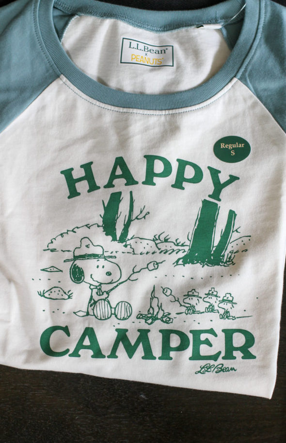 """A Snoopy t-shirt that says """"Happy Camper""""."""